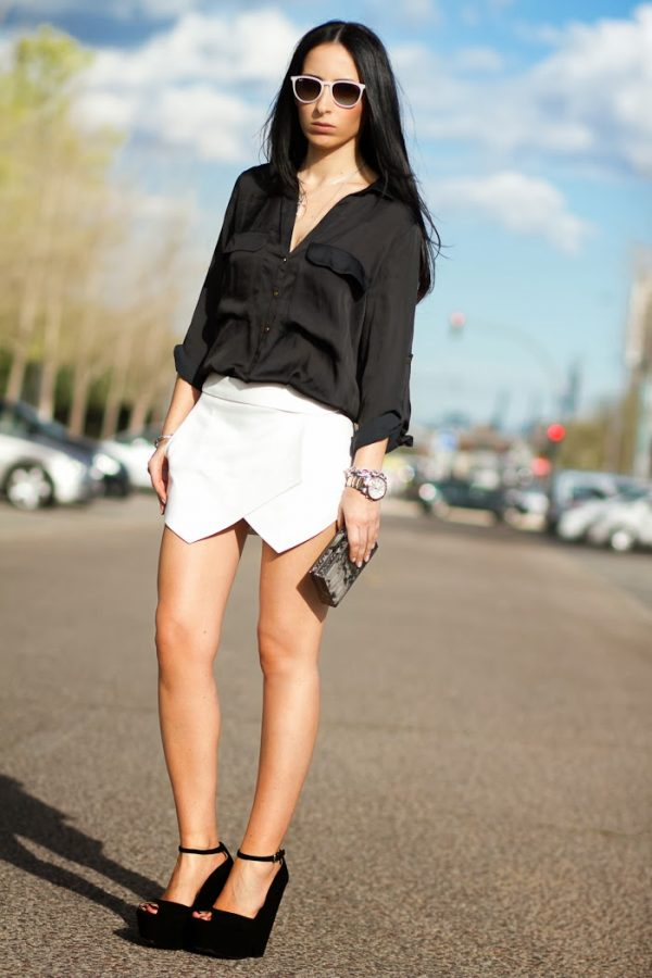 white skorts and black blouse