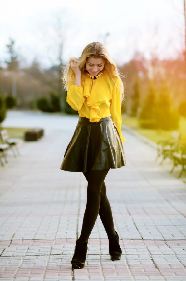 yellow blouse with black leather skirt bmodish
