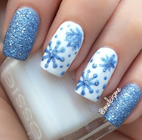 glitter blue snowflakes nailart bmodish - 33 Beautiful Snowflake Nail Art Designs - Be Modish