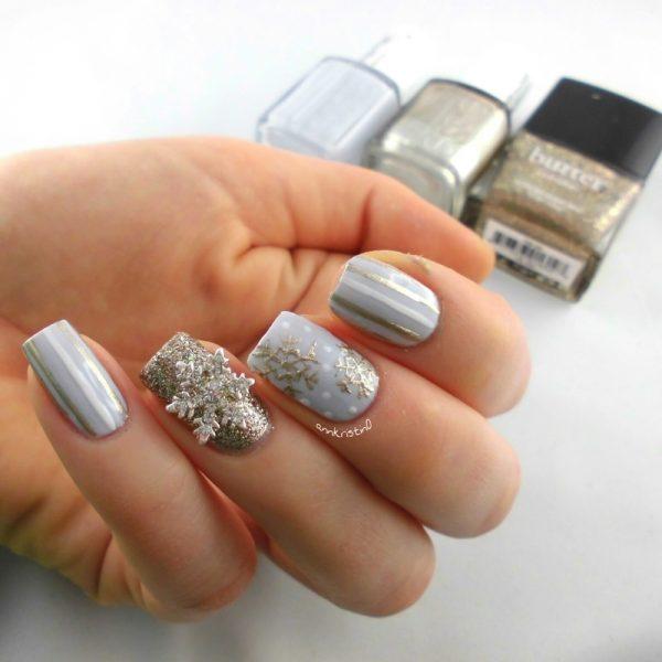 golden snowflakes nail design bmodish - 33 Beautiful Snowflake Nail Art Designs - Be Modish