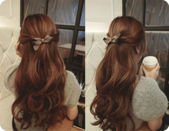 romantic half up hairstyle with bow