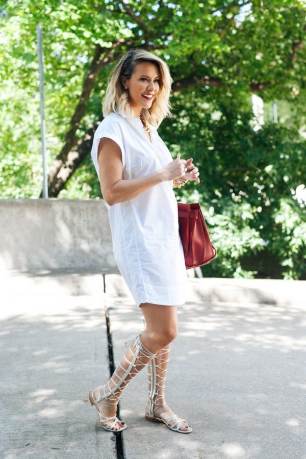 white dress, red tote and gladiator sandals