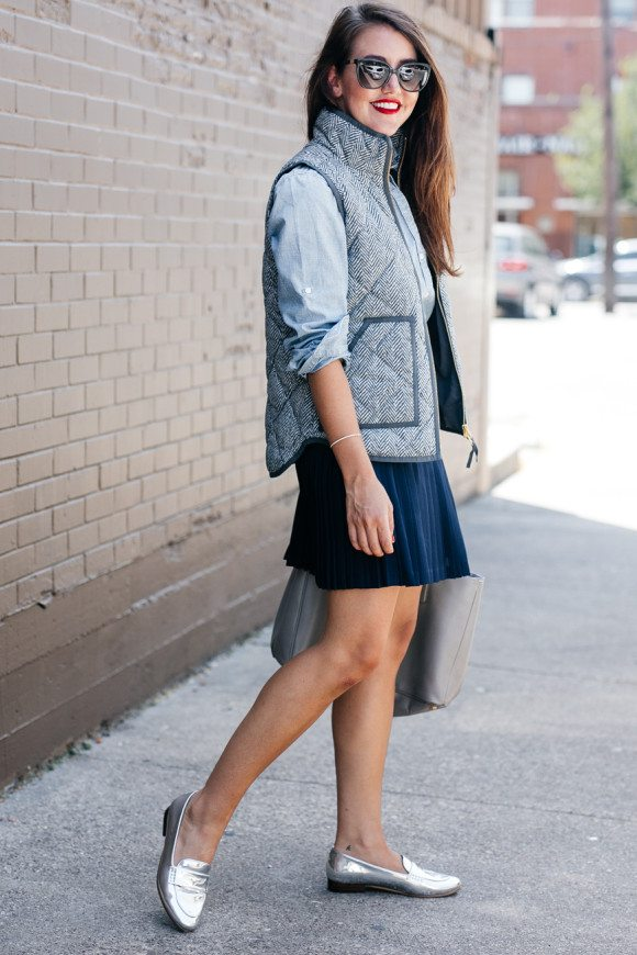 pleated skirt, vest and loafer outfit bmodish
