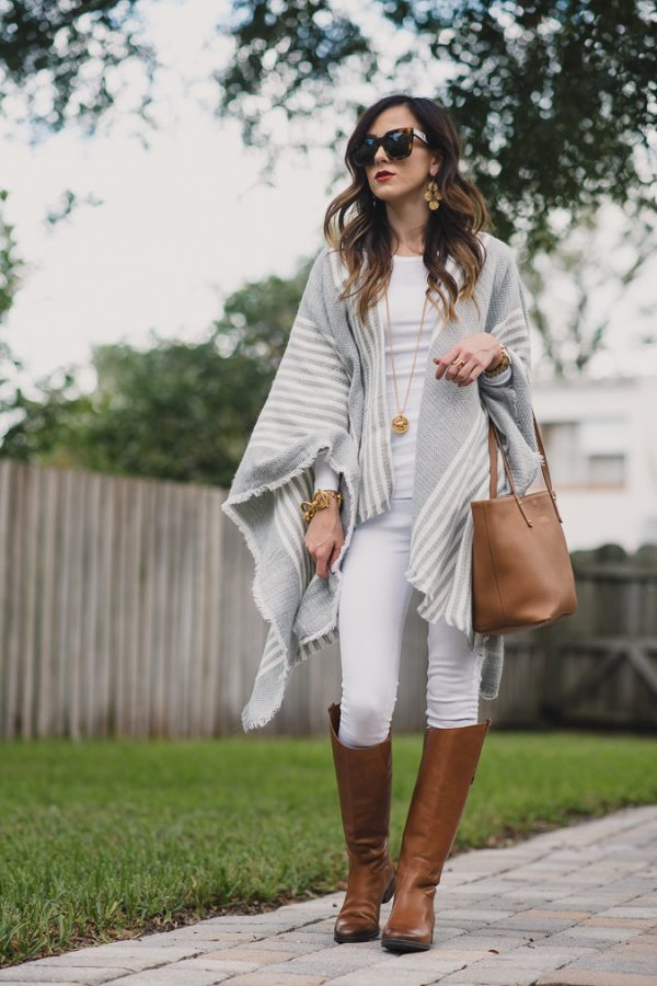brown boots white jeans and poncho fall outfit bmodish