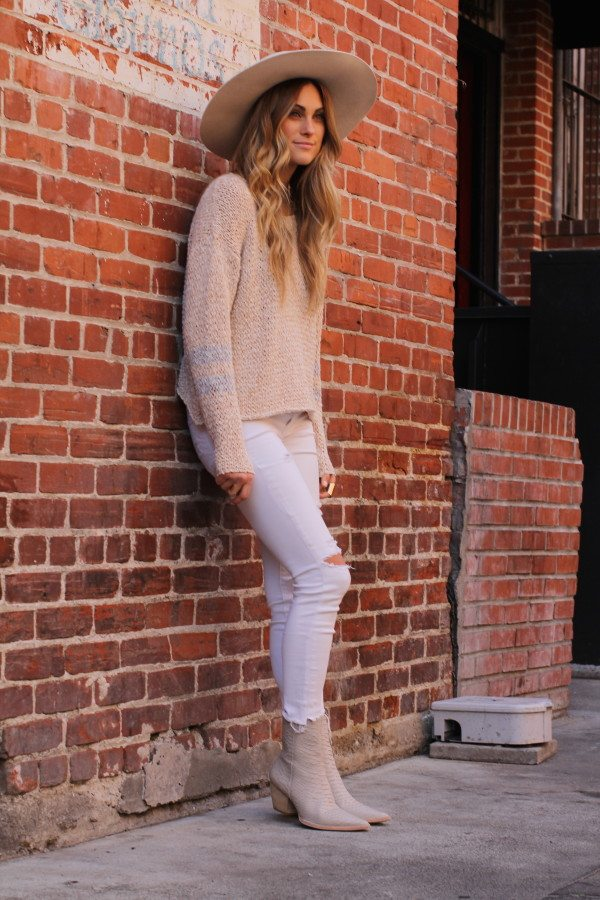 blush sweater with booties and white jeans bmodish