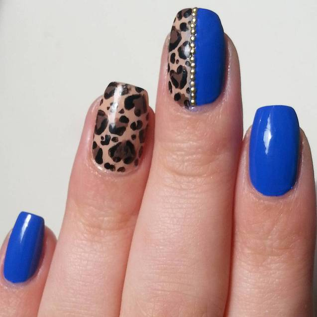 leopard with royal blue nails bmodish