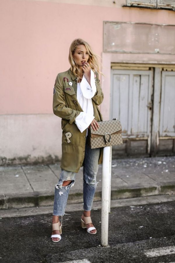 military jacket with ripped jeans casual outfit bmodish