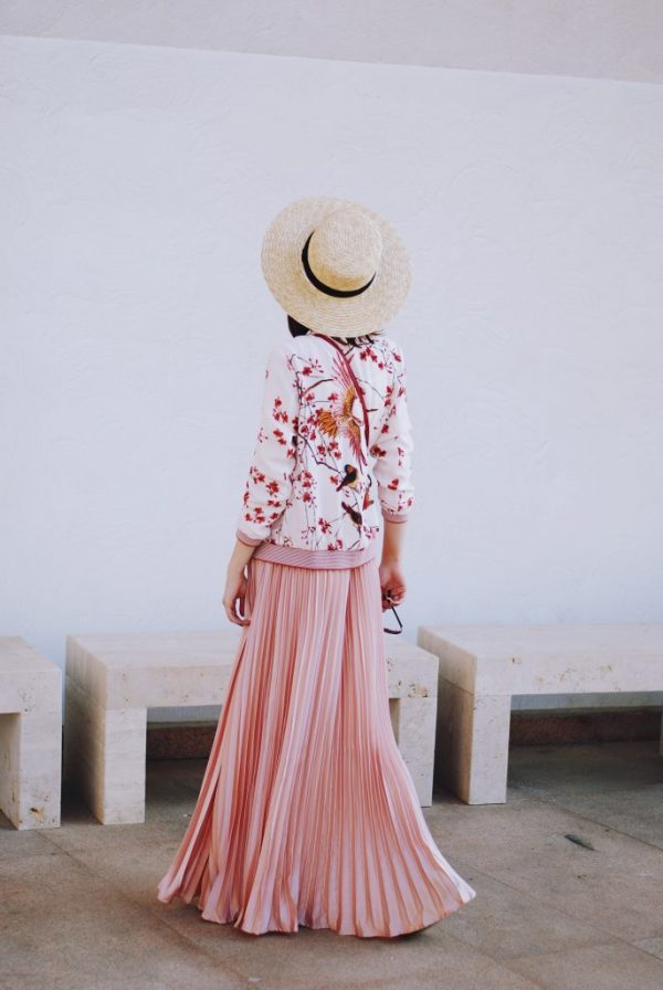 bomber-jacket-with-pleated-maxi-skirt-and-straw-hat-outfit-bmodish