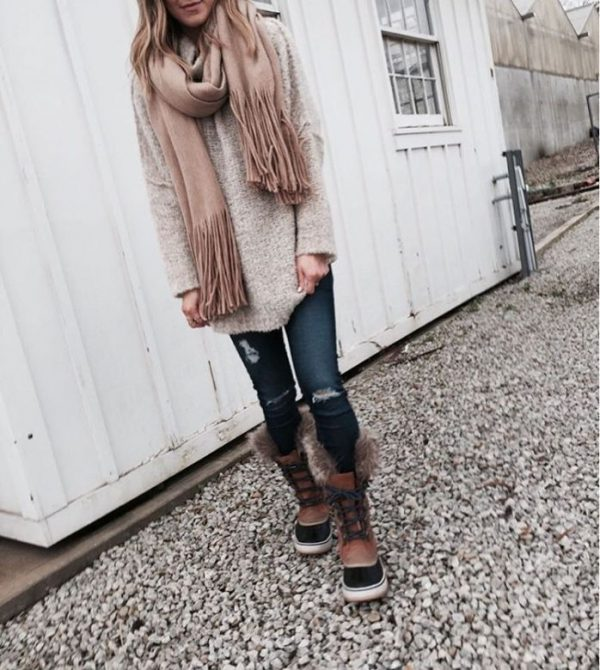 casual fall outfit with cozy sweater skinny jeans and sorel boots bmodish