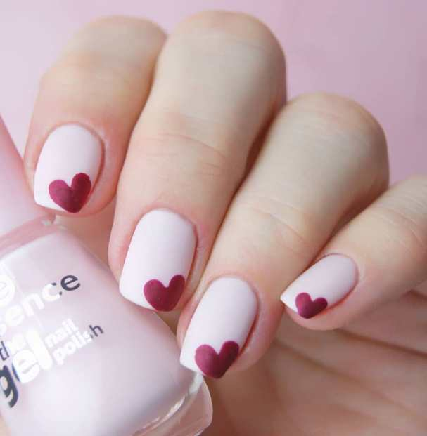 Tiny Red Hearts in Pink Nails