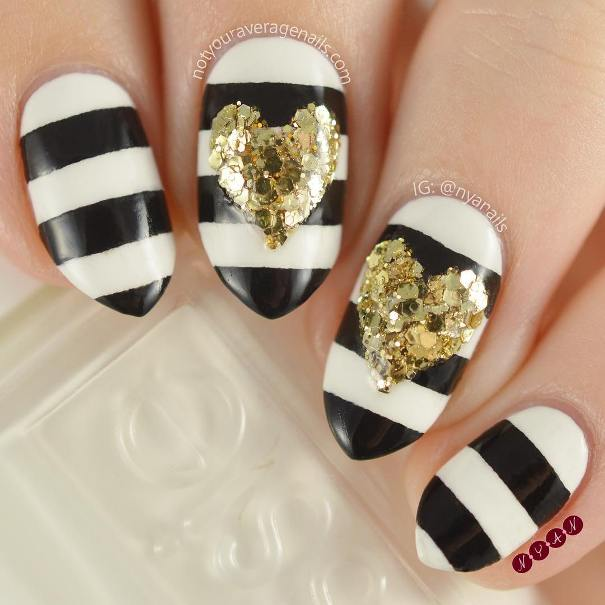 black and white stripe with glitter heart nail design