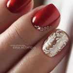 elegant embellished red and glitter gold nail design