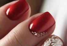 elegant embellished red and glitter gold nail design