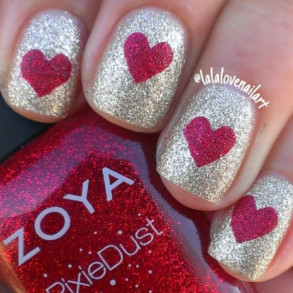 red hearts in glitter gold nail designs