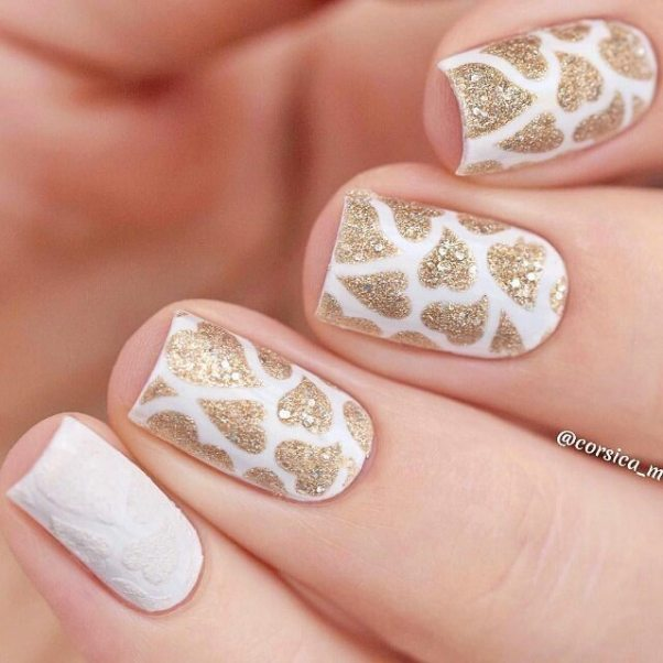 white and gold heart nail art