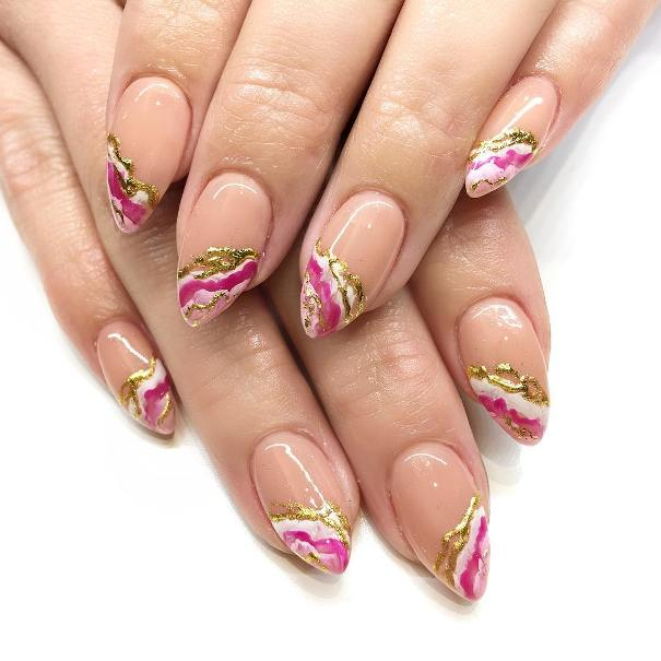 pink and gold geode almond shape nail design